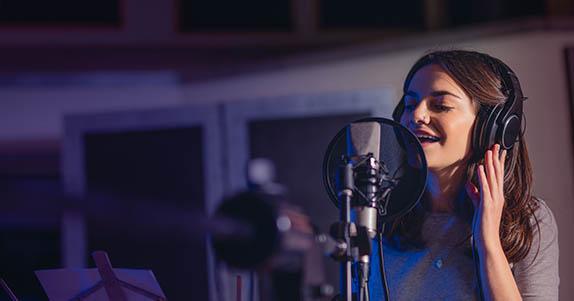 woman singing in studio
